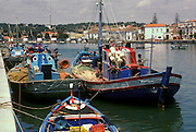PORTUGAL, ALGARVE, SOUTH COAST Tavira, pleasant fishing port on the Gil�no River with fishing boats