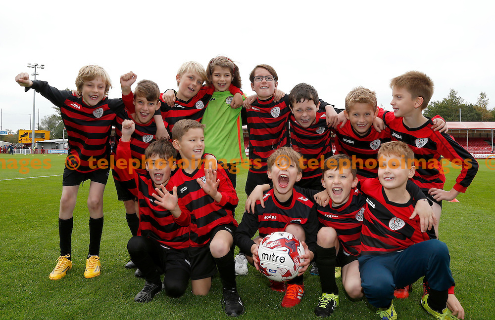 Young footballers seen before the Sky Bet League 2 match between Crawley Town and Luton Town at the Checkatrade.com Stadium in Crawley. October 17, 2015.<br /> James Boardman / Telephoto Images<br /> +44 7967 642437