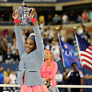 Serena Williams, USA, with her trophy watched by Victoria Azarenka, Belarus, after winning the Women's Singles Final at the US Open, Flushing. New York, USA. 8th September 2013. Photo Tim Clayton