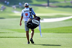May 2, 2019 - Charlotte, NC, U.S. - CHARLOTTE, NC - MAY 02: Brian Harman's caddie walks to the fairway on 16 in round one of the Wells Fargo Championship on March 02, 2019 at Quail Hollow Club in Charlotte,NC. (Photo by Dannie Walls/Icon Sportswire) (Credit Image: © Dannie Walls/Icon SMI via ZUMA Press)