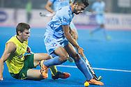 BHUBANESWAR (India) -  Hero Champions Trophy hockey men. Match for bronze. Australia vs India. Chandanda Thimmaiah of India with Tristan White (l) of Australia. Photo Koen Suyk