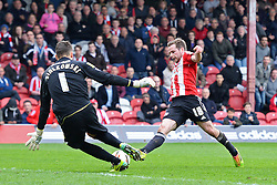 Notts County's goalkeeper Bartosz Bialkowski and Brentford's midfielder Alan Judge compete for the ball   - Photo mandatory by-line: Mitchell Gunn/JMP - Tel: Mobile: 07966 386802 05/04/2014 - SPORT - FOOTBALL -  Griffin Park - London - Brentford v Notts County- Sky Bet League One