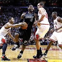 29 January 2012: Miami Heat small forward LeBron James (6) drives past Chicago Bulls center Joakim Noah (13) and Chicago Bulls point guard Derrick Rose (1) during the Miami Heat 97-93 victory over the Chicago Bulls at the AmericanAirlines Arena, Miami, Florida, USA.