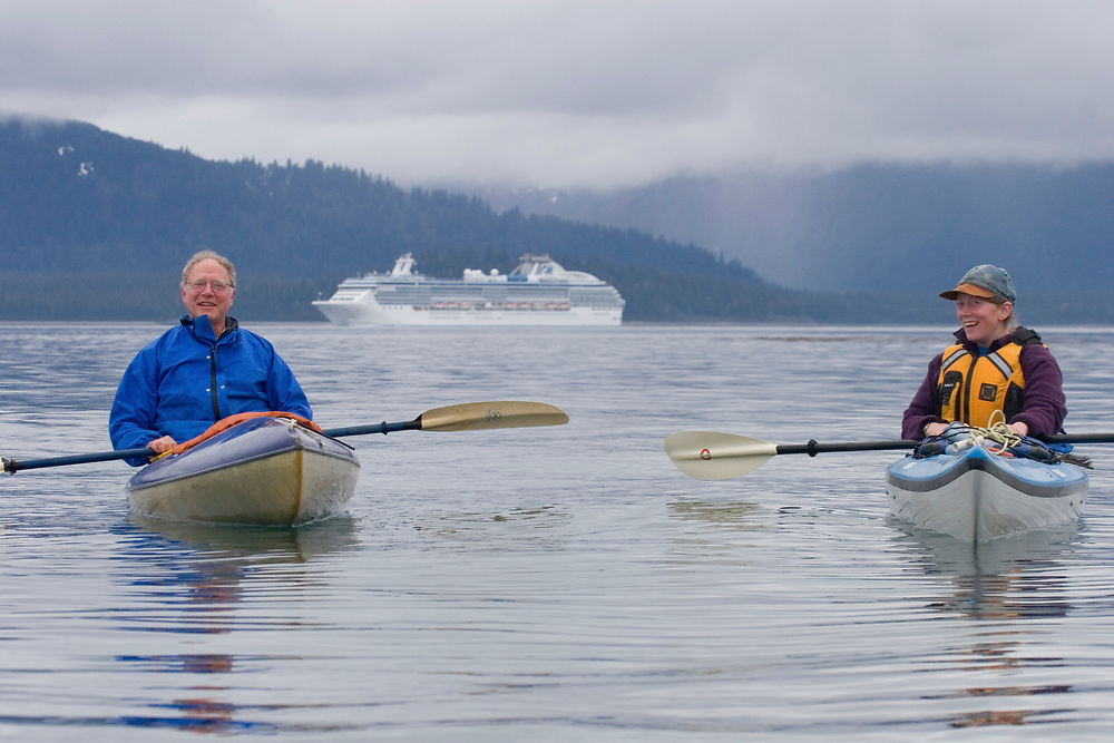 Kayakers in front of cruise ship