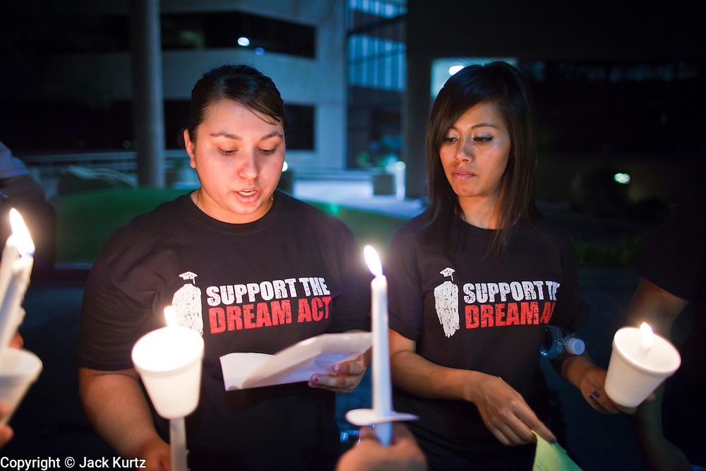 "Sept. 19 - PHOENIX, AZ: Phoenix students read letters from other students supporting the DREAM Act during a candlelight vigil in front of Sen. John McCain's office in Phoenix Sunday night. About 30 people met in front of US Sen. John McCain's office in Phoenix Sunday night to demonstrate in support of the DREAM Act, which is scheduled to be debated in the US Senate on Tuesday, Sept 21. The Development, Relief and Education for Alien Minors Act (The ""DREAM Act"") is a piece of proposed federal legislation in the United States that was introduced in the United States Senate, and the United States House of Representatives on March 26, 2009. This bill would provide certain illegal immigrant students who graduate from US high schools, who are of good moral character, arrived in the U.S. as minors, and have been in the country continuously for at least five years prior to the bill's enactment, the opportunity to earn conditional permanent residency. In the early part of this decade McCain supported legislation similar to the DREAM Act, but his position on immigration has hardened in the last two years and he no longer supports it. The protesters, mostly area students, marched and drilled to show their support for the US military and then held a candle light vigil.   Photo by Jack Kurtz"