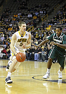 February 2 2011: Iowa Hawkeyes guard Matt Gatens (5) drives past Michigan State Spartans guard Keith Appling (11) during the first half of an NCAA college basketball game at Carver-Hawkeye Arena in Iowa City, Iowa on February 2, 2011. Iowa defeated Michigan State 72-52.