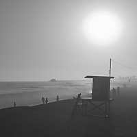 Lifeguard Tower M sunset black and whiite photo in Newport Beach, CA. Newport Beach is a popular coastal city along the Pacific Ocean in Orange County Southern California. Photo is Copyright ⓒ 2017 Paul Velgos with All Rights Reserved.