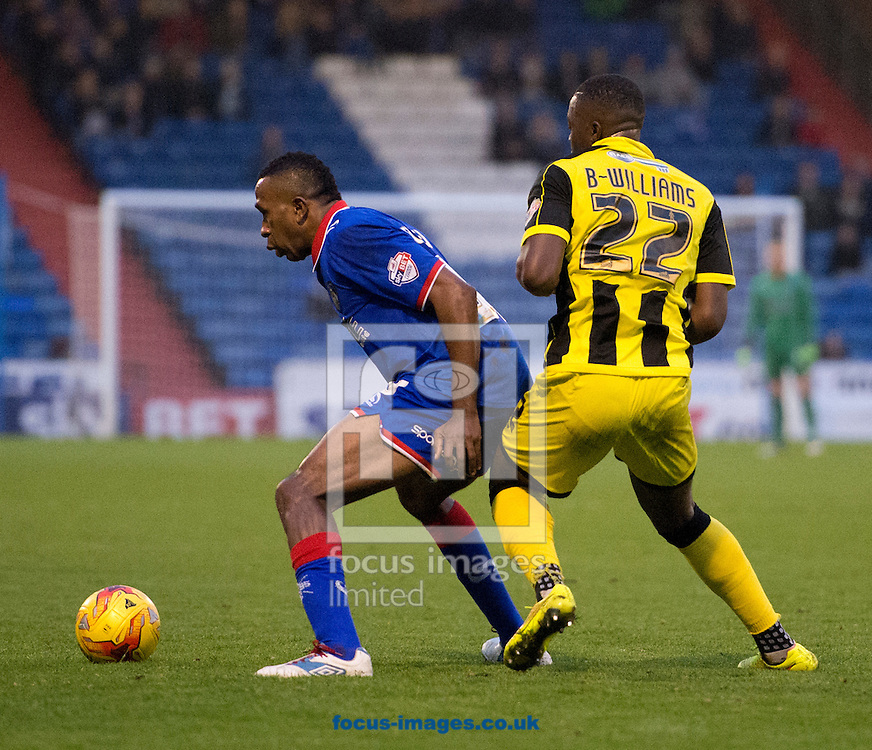 Ricardo Fuller of Oldham Athletic (left) turns away from Jerome Binnom-Williams of Burton Albion during the Sky Bet League 1 match at Boundary Park, Oldham<br /> Picture by Russell Hart/Focus Images Ltd 07791 688 420<br /> 31/10/2015