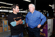 CINCINNATI, OH - OCTOBER 5:  Nick Lachey talks with Freestore Foodbank president and CEO John Young during the kickoff to The Everybody Wins Tour at Freestore Foodbank on October 5, 2009 in Cincinnati, Ohio. (Photo by Joe Robbins/WireImage for Foodbank)