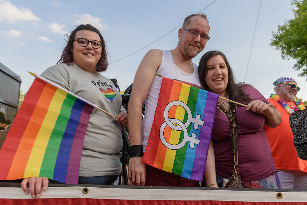 Aimee Nieto, Shawn Mason and Lindsey Doyle on the Tryangles and Teddy Bear trailer before the parade.<br /> The Lesbian, Gay, Bisexual, Transgender, and Queer (LGBTQ) community and their friends, family and supporters walked and lined Main Street from Floyd Street to the Belvedere for the Kentuckiana Pride Parade, Saturday, June 16, 2017 in Louisville, Ky. (Photo by Brian Bohannon)