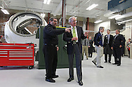 Energy Production and Distribution Technology Instructor David Bennett shows Senator Tom Harkin (D-IA) the various student stations as he takes a tour of Jones Hall at Kirkwood Community College in Cedar Rapids on Monday, March 5, 2012. Stephen Mally/Freelance)