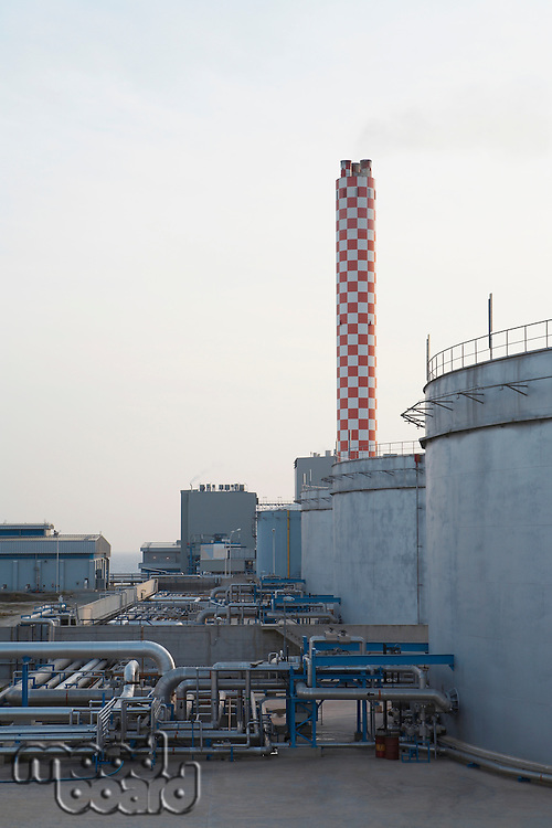 Fuel depot at power station with smokestack in background