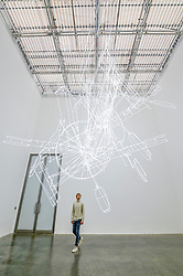"© Licensed to London News Pictures. 06/02/2020. LONDON, UK. A staff member views ""fig. (0)"", 2020, by Cerith Wyn Evans. Preview of ""No realm of thought... No field of vision"" by Cerith Wyn Evans at the White Cube gallery in Bermondsey.  The exhibition runs 7 February to 19 April 2020.  The show comprises installations, sculpture and painting.  Photo credit: Stephen Chung/LNP"