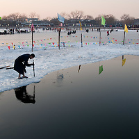 BEIJING CHINA 3rd FEBRUARY A local prepares to swim in the frozen waters of Houhai Lake, in the central area of the city, When the lake  is frozen,  it becomes  a large ice skating rink and a popular winter playground for people of all ages. (Lin Qiu Yan /XianPix...***Standard Licence  Fee's Apply To All Image Use***.XianPix Pictures  Agency . tel +44 (0) 771 7298571. e-mail sales@xianpix.com .www.xianpix.com