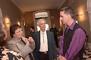 Suzanne Thompson and William Baasel talk with Gregory Barsamian, freinds of the museum--after the Artist Gallery Talk on Friday at the reception at the Kennedy Museum of Art