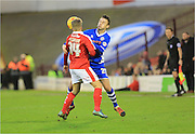 Michael Rose, Lloyd Isgrove during the Sky Bet League 1 match between Barnsley and Rochdale at Oakwell, Barnsley, England on 23 January 2016. Photo by Daniel Youngs.