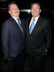 Andrew Coney General Manager of the InterContinental Westminster with DR Liam Fox (R)  at The InterContinental Westminster  Political Party. London, United Kingdom. Wednesday, 11th September 2013. Picture by Andrew Parsons / i-Images
