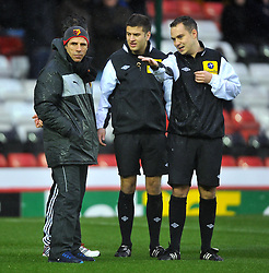 Bristol City Manager, Derek McInnes and Watford Manger, Gianfranco Zola talk to Referee Michael Naylor before he calls the game off - Photo mandatory by-line: Joe Meredith/JMP  - Tel: Mobile:07966 386802 26/12/2012 - Bristol City v Watford - SPORT - FOOTBALL - Championship -  Bristol  - Ashton Gate Stadium -