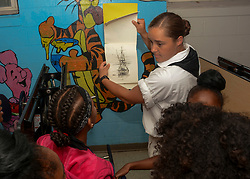 MILWAUKEE (Aug. 6, 2018) Seaman Ashley Watson, assigned to USS Constitution, interacts with children at the Boys & Girls Clubs of Greater LaVarnway during Milwaukee Navy Week. The Navy Office of Community Outreach uses the Navy Week program to bring Navy Sailors, equipment and displays to approximately 14 American cities each year for a week-long schedule of outreach engagements designed for Americans to experience first hand how the U.S. Navy is the Navy the nation needs. (U.S. Navy photo by Mass Communication Specialist 3rd Class Casey Scoular)180806-N-SM577-0081