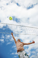 Teenage boy (16-17) playing volleyball low angle view