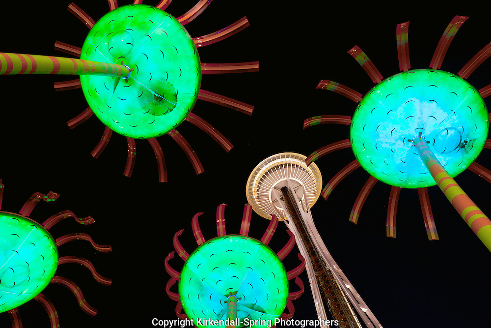 WA09405-00...WASHINGTON - Sconic Bloom sculpture and Space Needle at night in Seattle Center.