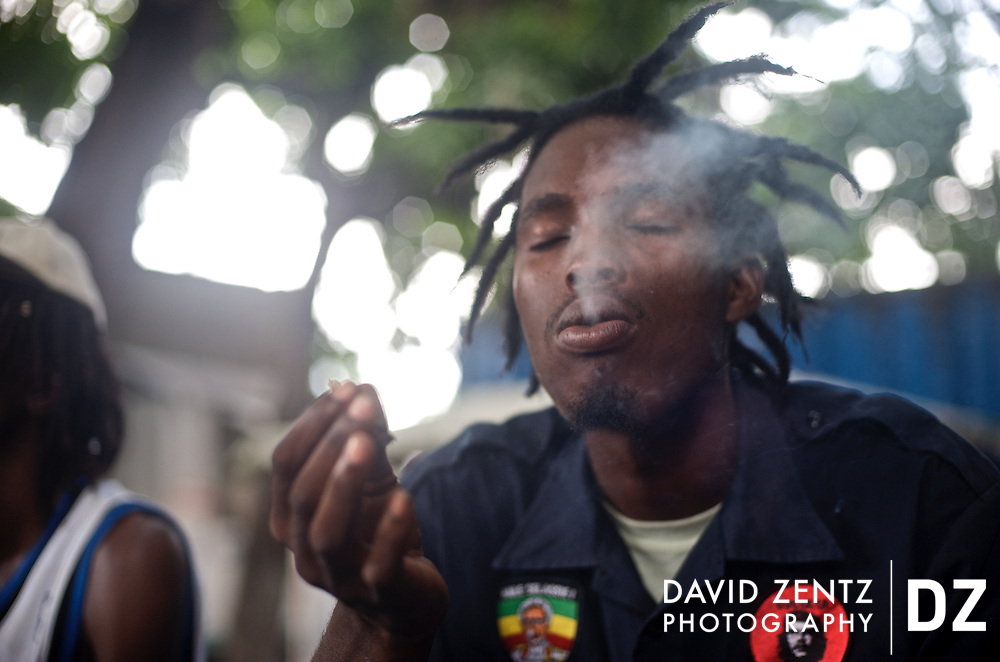 2Double smokes a joint with friends at the Koze Kreyol recording studio in Port-au-Prince, Haiti on July 28, 2008.