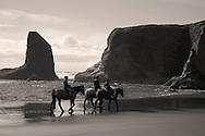 three riders on horses