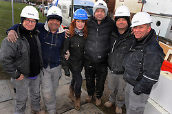 © Licensed to London News Pictures. 12/03/2013.The BBC's DIYSOS team are in Orpington, Kent this week till the (21.03.2013). Nick Knowles and the team of builders  which includes local tradesmen arrived on the (12.03.2013) to help build a family in need a new home..LTR.Mark Millar - Builder.Billy Byrne - Electrician.Gabrielle Blackman - Designer.Nick Knowles-Presenter.Julian Perryman - Builder    .Chris Frediani - Builder..Photo credit : Grant Falvey/LNP