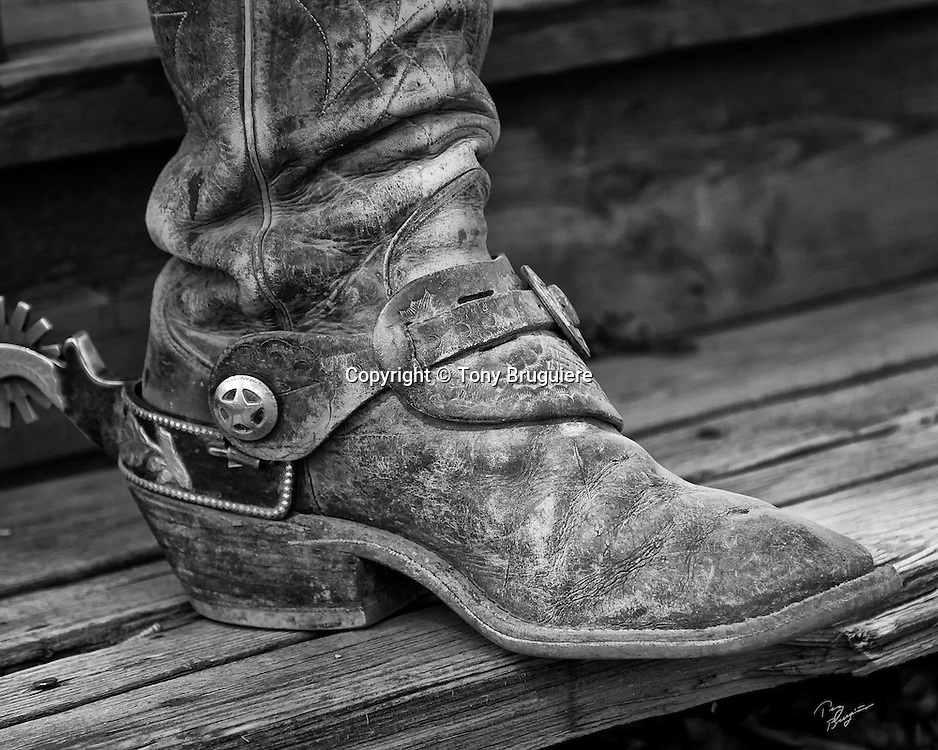 The boot and spur of a working ranch cowboy in southern Colorado