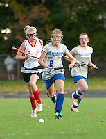 Gilford's Laura Zakorchemny gets ahead of Laconia's Lindsey Drouin as they charge down field during Thursday Middle School Field Hockey at Opechee Park.  (Karen Bobotas/for the Laconia Daily Sun)