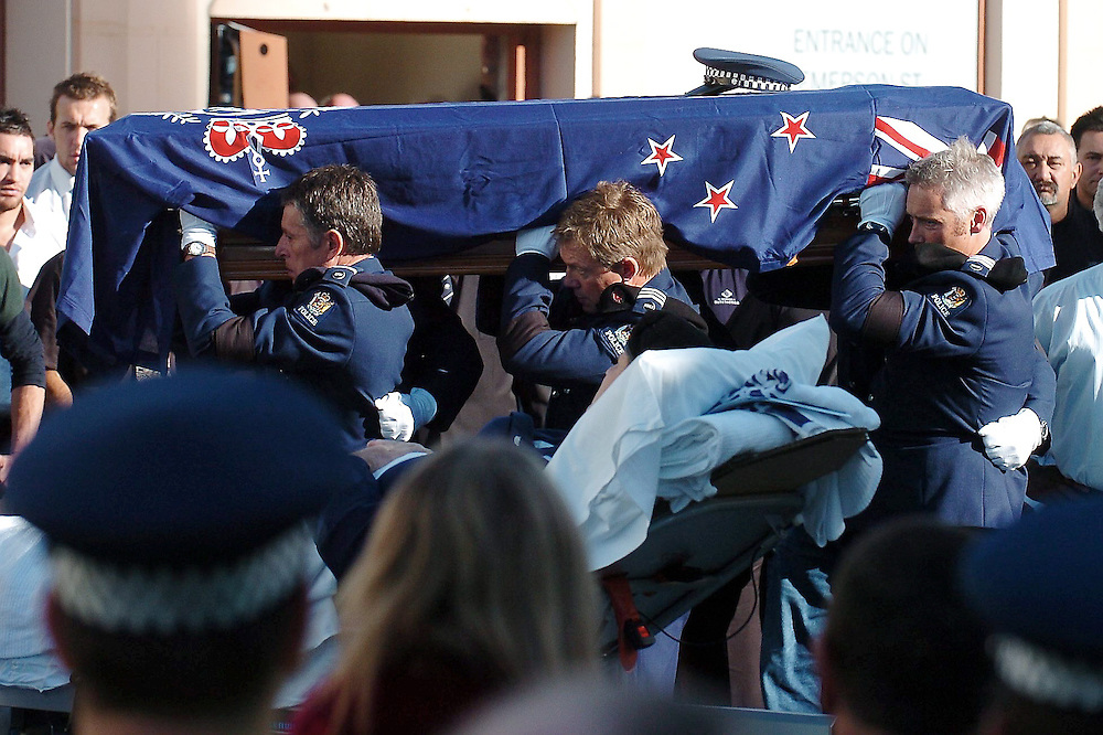 The casket of Senior Constable Len Snee is carried past Senior Sargent Grant Diver in his hospital bed, Municipal Theatre, Napier, New Zealand, Wednesday, May 13, 2009. Credit: SNPA / Kerry Marshall