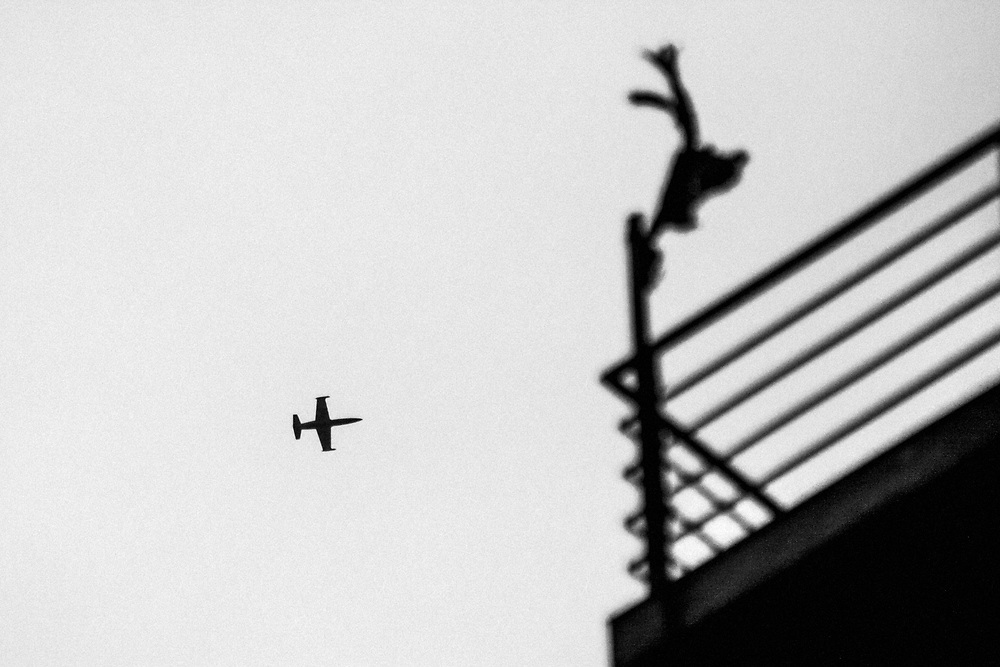 Aleppo, Syria, 2012/10/09.<br /> The sky over Tareeq Al-Bab district.<br /> A fighter jet is flying over the Dar Al-Shifaa hospital.