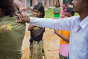 Tabasum Khatun, 14, (left) and her best friend Anju Kumari, 13, are observing a Karate counter-attack move during a class in Algunda village, pop. 1000, Giridih District, rural Jharkhand, India.