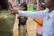 Tabasum Khatun, 14, (left) and her best friend Anju Kumari, 13, are observing a Karate counter-attack move during a class in Algunda village, pop. 1000, Giridih District, rural Jharkhand, India.