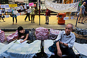 A month has gone since the beginning of the Umbrella movement but 3 major sites of Hong Kong are still occupied by the students.<br /> <br /> A student is doing her home work in Causeway Bay occupied site as bystanders are reading pro democracy posters<br /> <br /> 30th day of pro-democracy protest in Hong Kong.<br /> <br /> The mass rallies are one of the biggest challenges to Beijing's authority since the Tiananmen pro-democracy protests of 1989