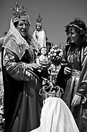 A woman holding baby Jesus instructs a little girl during the procession of St. Bartolomeu. The procession to thank the Saint incorporates hundreds of extras and large litters, which reconstruct biblical episodes. This tradition that dates back to the sixteenth century (1566), and it claims the devil is on the loose during this day. Every year on 24 August  faith and tradition join thousands of people at the feast of St. Bartolomeu do Mar, for ritual that mixes the sacred and the profane.