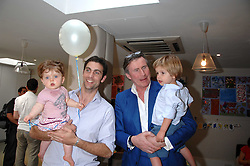 Left to right, HUGH VAN CUTSEM and his dayghter GRACE, BERTIE WAY and his son BEN at a party to celebrate the 21st birthday of the children's charity Starlight held at Maggie & Rose, 58 Pembroke Road, London W8 on 12th May 2008.<br />