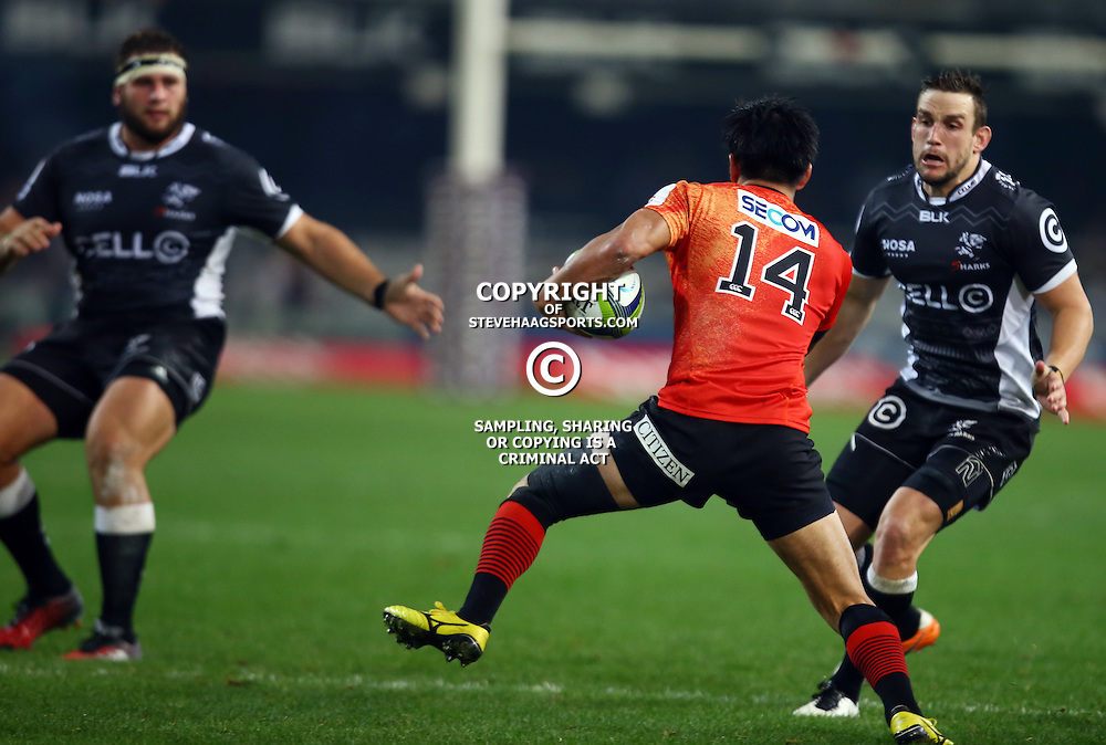 DURBAN, SOUTH AFRICA - JULY 15: Keegan Daniel of the Cell C Sharks looks to tackle Hajime Yamashita of the Sunwolves during the Super Rugby match between the Cell C Sharks and Sunwolves at Growthpoint Kings Park on July 15, 2016 in Durban, South Africa. (Photo by Steve Haag/Gallo Images)