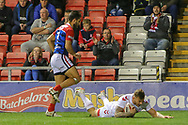 Tom Johnstone of England scores his second ahead of William Barthau of France during the International Friendly match at Leigh Sports Village, Leigh<br /> Picture by Steve McCormick/Focus Images Ltd 07545 862647<br /> 17/10/2018