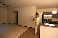 Kevin Hunter of Hunter Appraisal Service takes a photo of the living room as he reviews a new construction home at 403 Cimarron Drive, in Hiawatha on Friday morning, June 29, 2012.