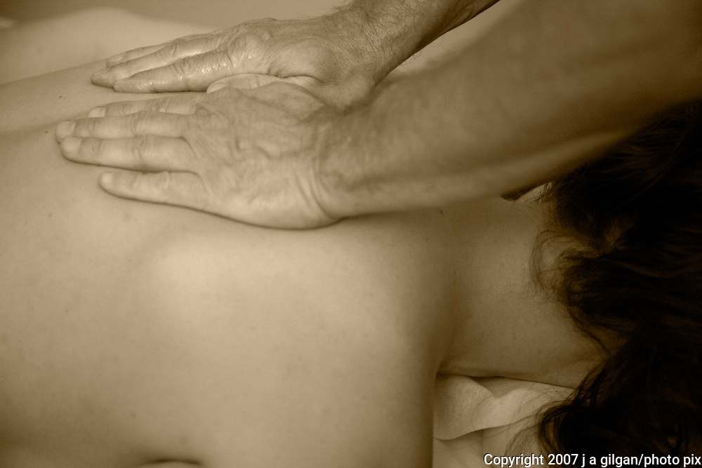 woman receiving back massage during Swedish massage. Sepia tone