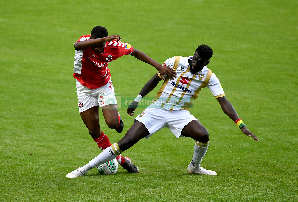 Charlton Athletic's Anfernee Dijksteel (left) and Milton Keynes Dons' Ousseynou Cisse (right) battle for the ball
