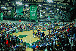 21 February 2015:  Shirk Center is packed and the new Dennie Bridges Court markings are on the floor during an NCAA men's division 3 CCIW basketball game between the Elmhurst Bluejays and the Illinois Wesleyan Titans in Shirk Center, Bloomington IL<br /> <br /> This image is an HDR Composite of 3 single images layered together and should be noted as an illustration if used editorially.