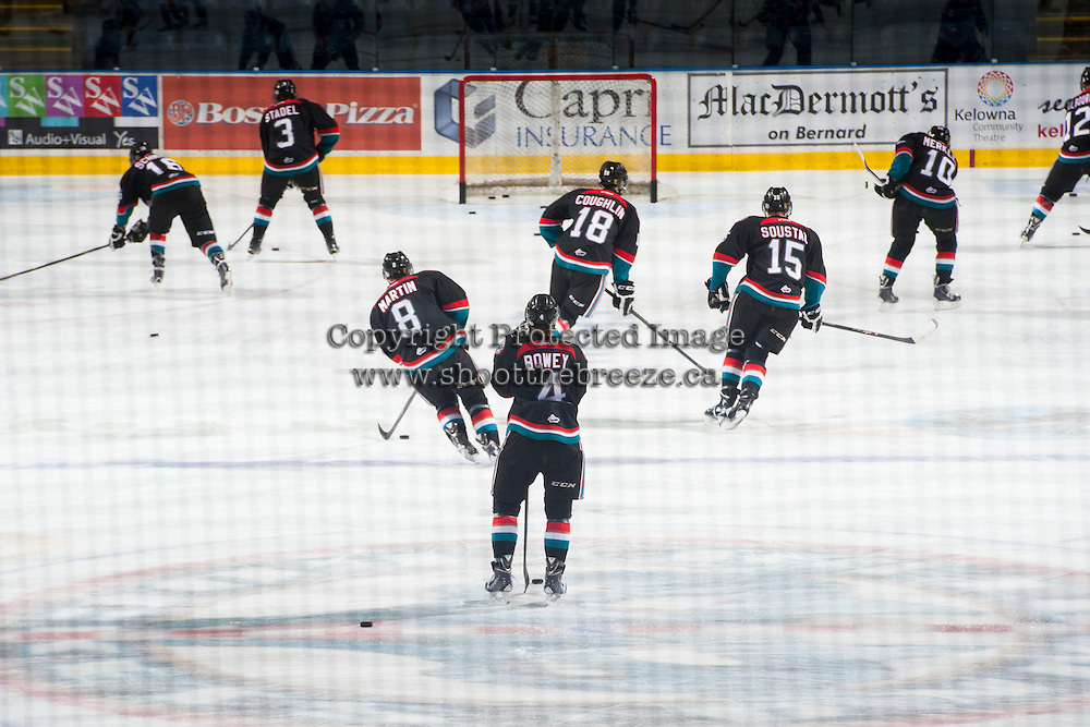 KELOWNA, CANADA - DECEMBER 5: Kelowna Rockets Captain, Madison Bowey #4, stands at centre ice during warm up against the Prince George Cougars on December 5, 2014 at Prospera Place in Kelowna, British Columbia, Canada.  (Photo by Marissa Baecker/Shoot the Breeze)  *** Local Caption *** Madison Bowey;