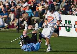 Virginia defenseman Matt Kelly (33) knocks over Johns Hopkins defenseman Matt Bocklet (7).  The #2 ranked Virginia Cavaliers defeated the #6 ranked Johns Hopkins Blue Jays 13-12 in overtime at the University of Virginia's Klockner Stadium in Charlottesville, VA on March 22, 2008.  The loss, in front of a record UVA crowd of 7,500, was the third consecutive overtime defeat for Hopkins, the defending national champions.