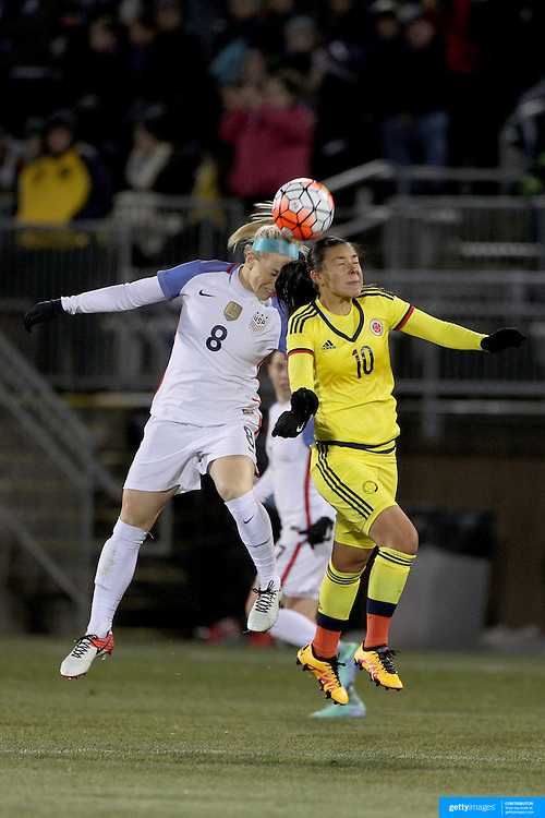 Julie Johnston, (left), USA, and Yoreli Rincón, Colombia, challenge for the ball during the USA Vs Colombia, Women's International friendly football match at the Pratt & Whitney Stadium, East Hartford, Connecticut, USA. 6th April 2016. Photo Tim Clayton