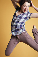 Young woman jumping and screaming