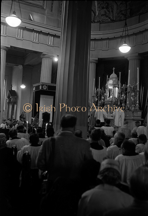 25/07/1962<br /> 07/25/1962<br /> 25 July 1962<br /> Consecration Rev. Dr Grimley S.M.A. as Bishop of Cape Palmas, Liberia at the Pro Cathedral, Dublin. Picture shows a general view of the altar in the Pro-Cathedral during the ceremony of consecration as the new Bishop Rev Grimley (on right of altar) and Most Rev. Dr McQuaid, Archbishop of Dublin (in centre of altar) Consecrating Prelate continue the Mass.