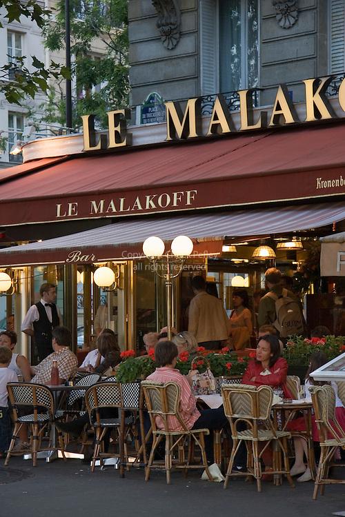 People eating at Le Malakoff restaurant at Place du Trocadero, Paris France<br />