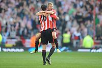 Football - Premier League - Sunderland vs.  Newcastle United<br /> Sebastian Larsson and John O'Shea (Sunderland) celebrate the goal at the Stadium of Light